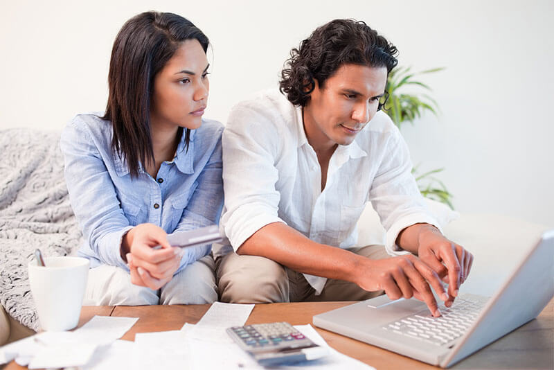 couple planning finances on laptop computer